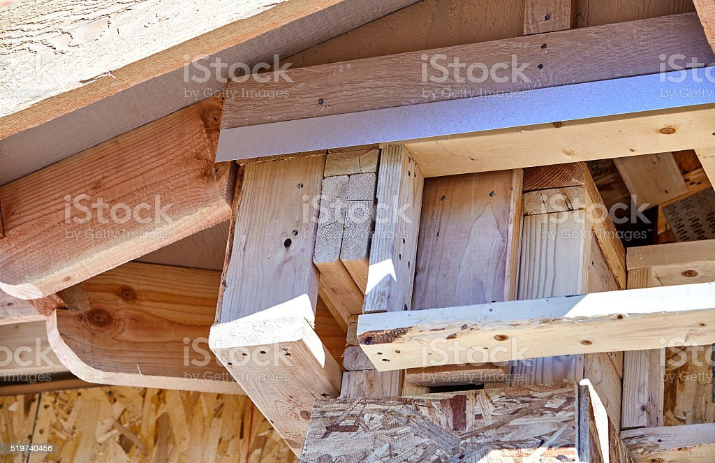 Home Building Construction Carpentry corner post roof eave frami stock photo
