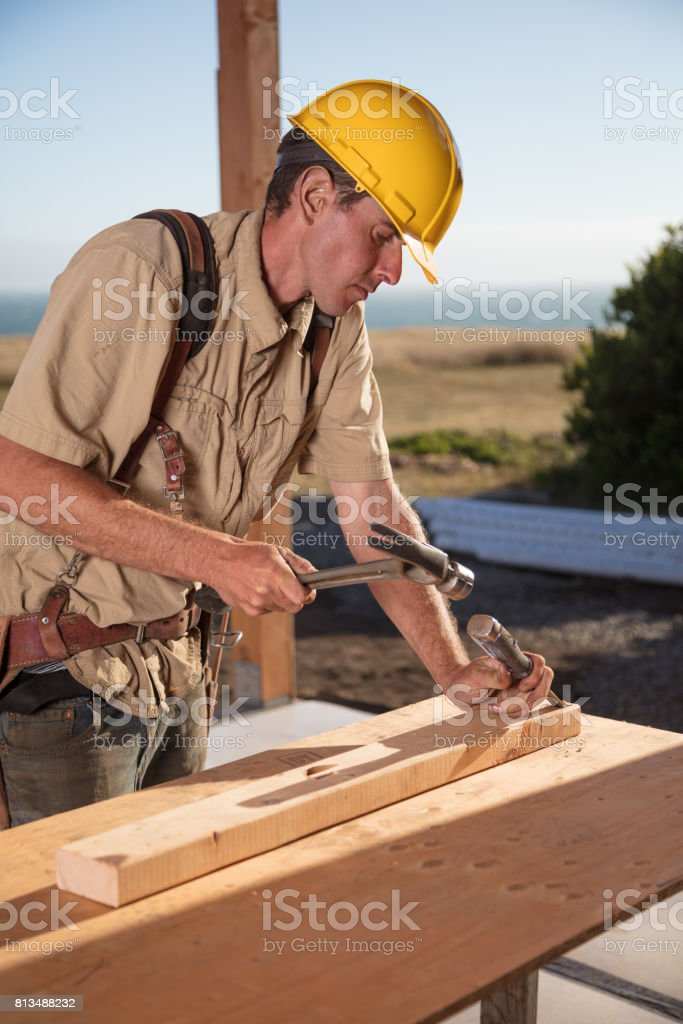 Home Building - Hammer & Chisel stock photo
