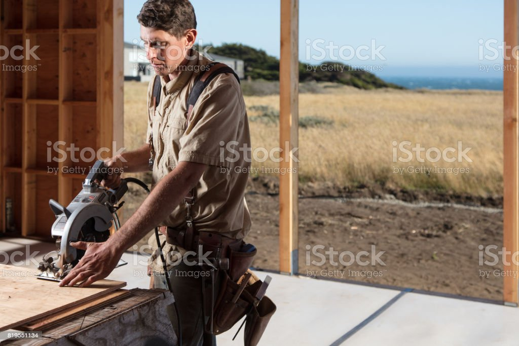 Home Building - Sawing stock photo