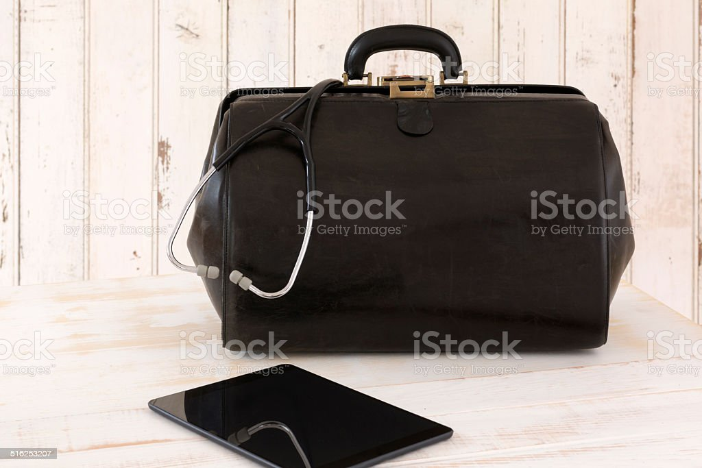Home call, doctor's bag with stethoscope and Tablet stock photo