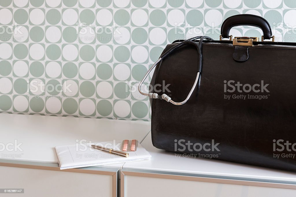 Home call, doctor's bag with stethoscope stock photo