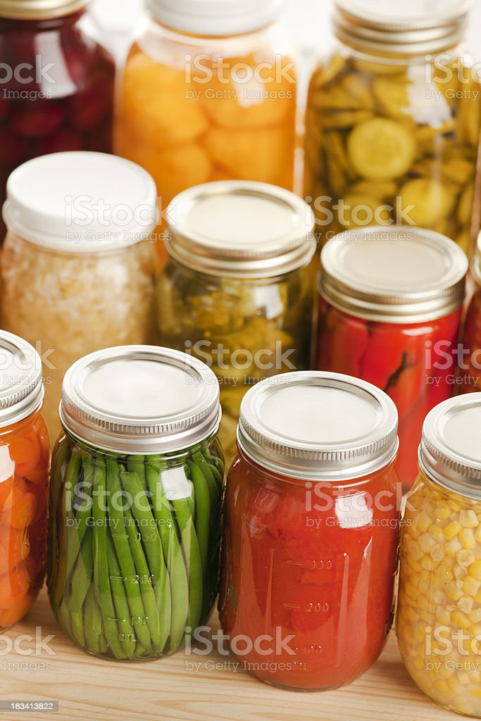 Home Canning Jars of Fall Harvest Vegetables and Fruit Vt stock photo