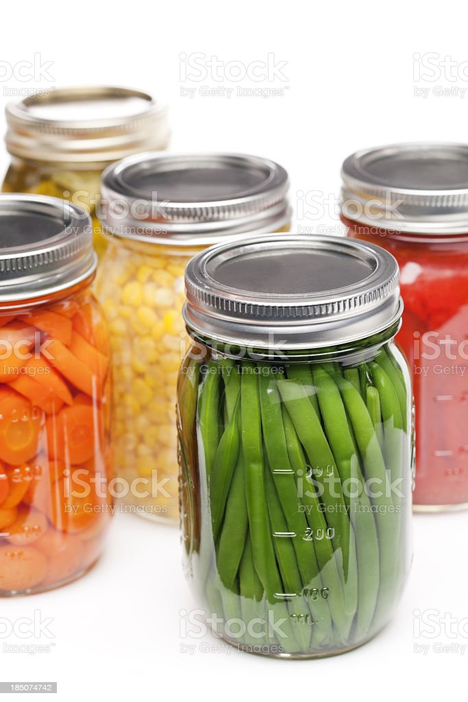 Home Canning Jars of Summer Harvest Vegetable Close-up on White stock photo