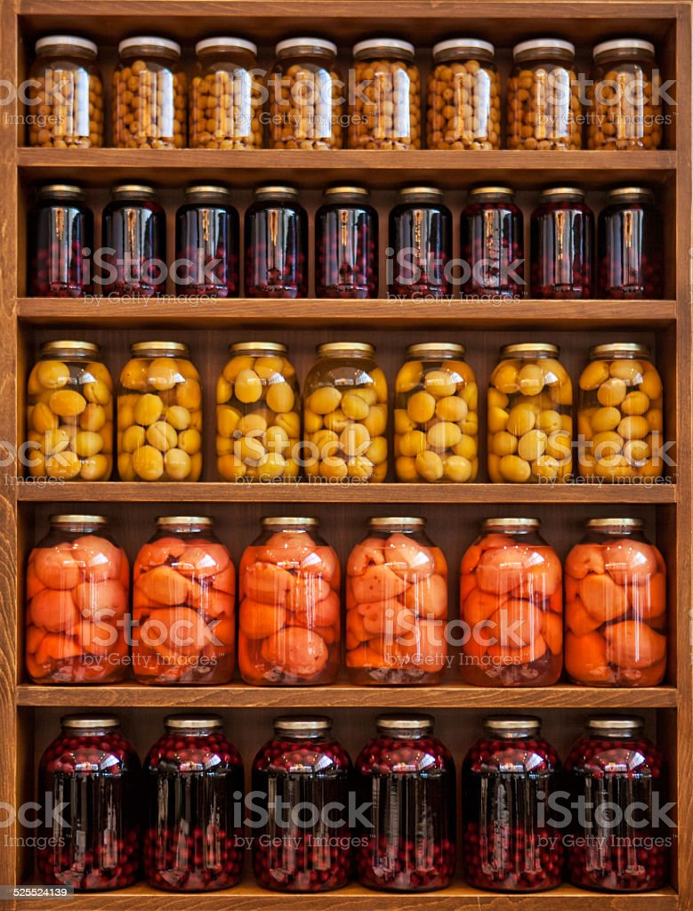 Home Canning of Summer Vegetables on Shelves stock photo