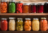 Home Canning, Preserving, Pickling Food Stored on Wooden Storage Shelves