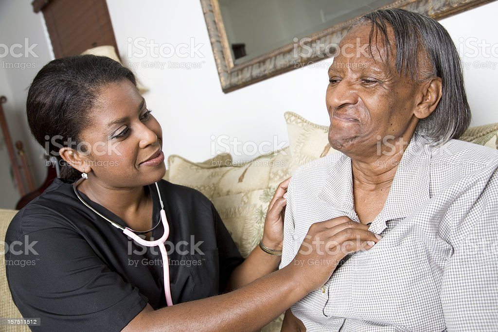 Home Caregiver Checking Heart Rate of Patient royalty-free stock photo