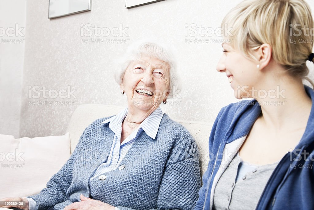 home caregiver talking with senior woman royalty-free stock photo