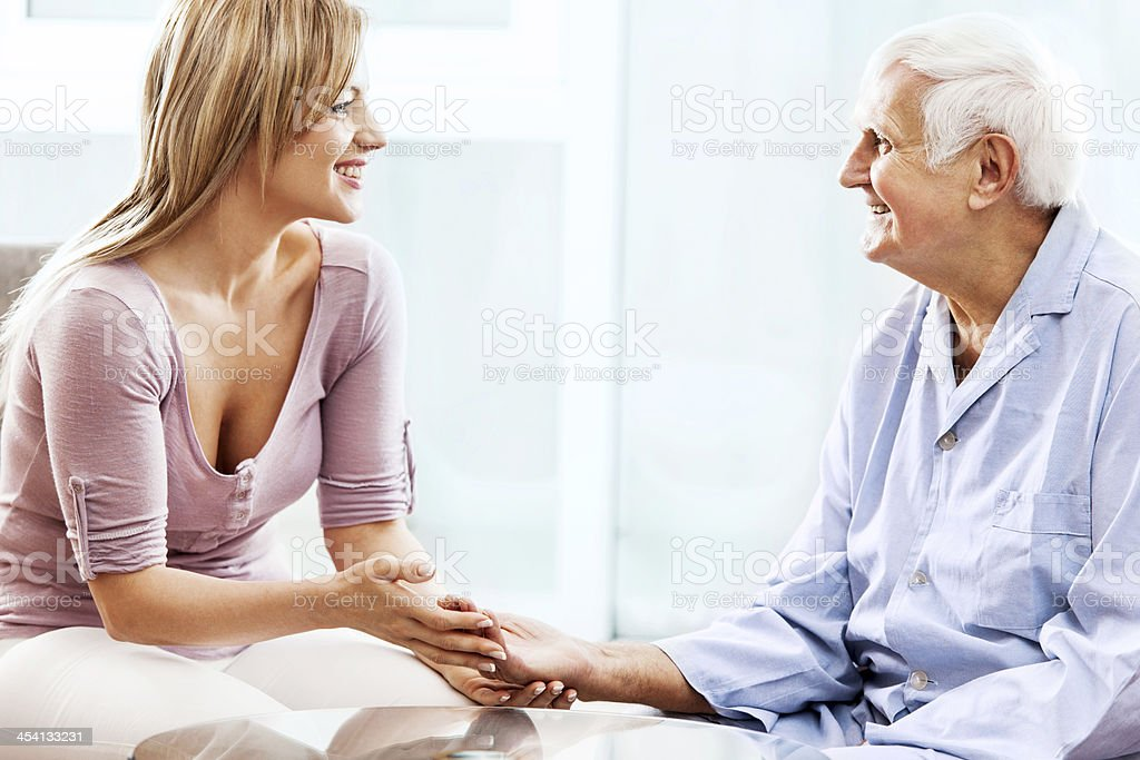 Home caregiver with a patient. royalty-free stock photo