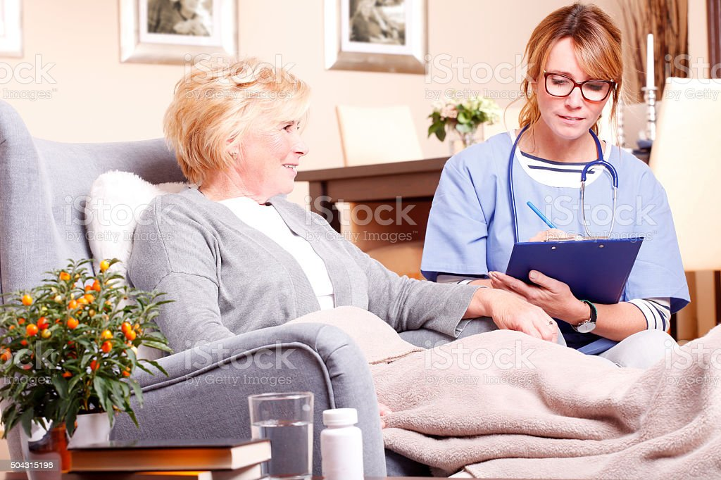 Home caregiver working stock photo