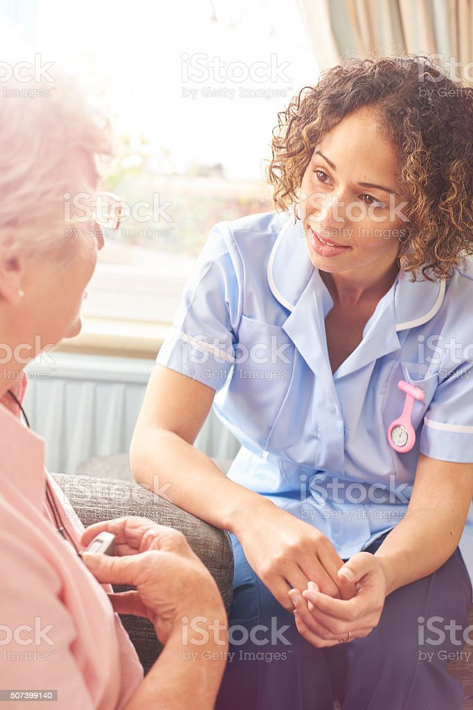 home carer visit stock photo
