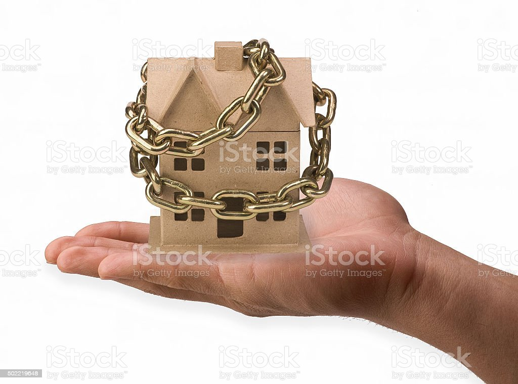 Home chained in hand. stock photo