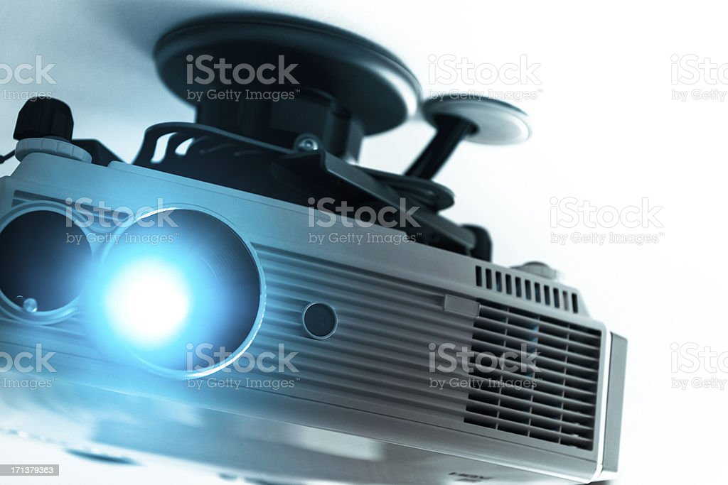 Home cinema projector on the ceiling stock photo