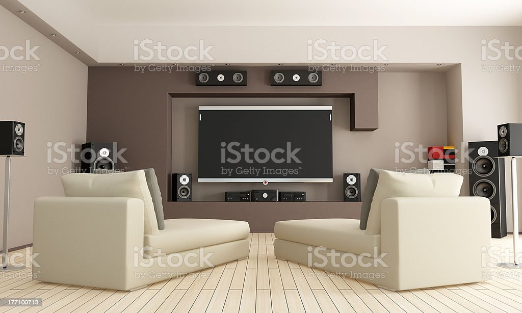 Home cinema room with two lounge chairs royalty-free stock photo