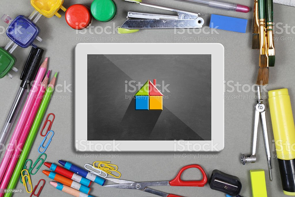 Home concept on digital table with office supplies desk stock photo