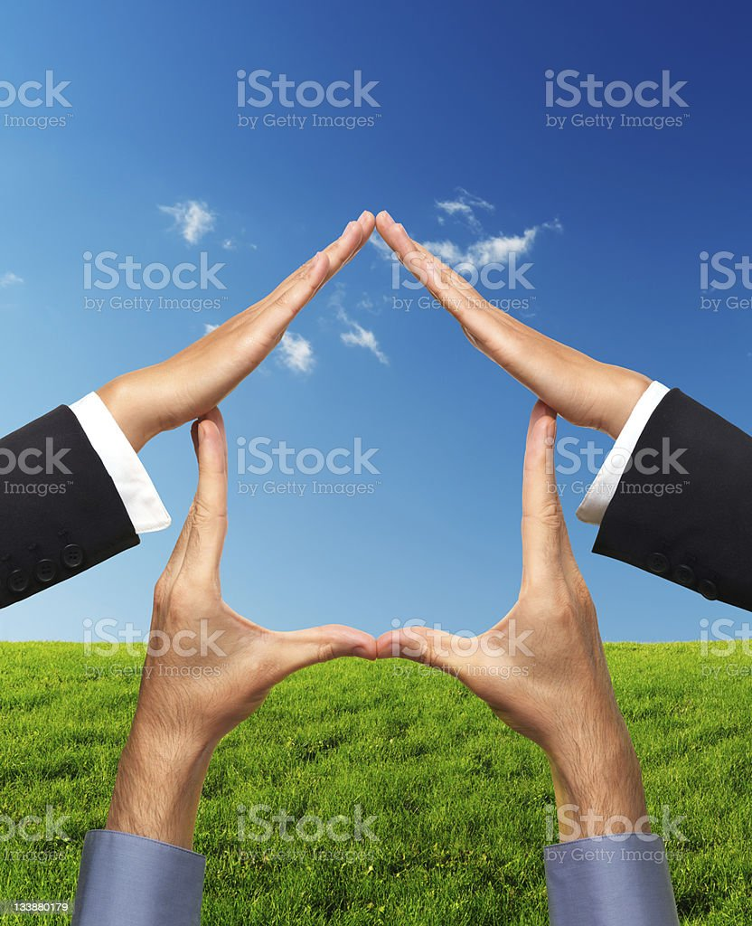 Home Conceptual Symbol Made by Hands stock photo