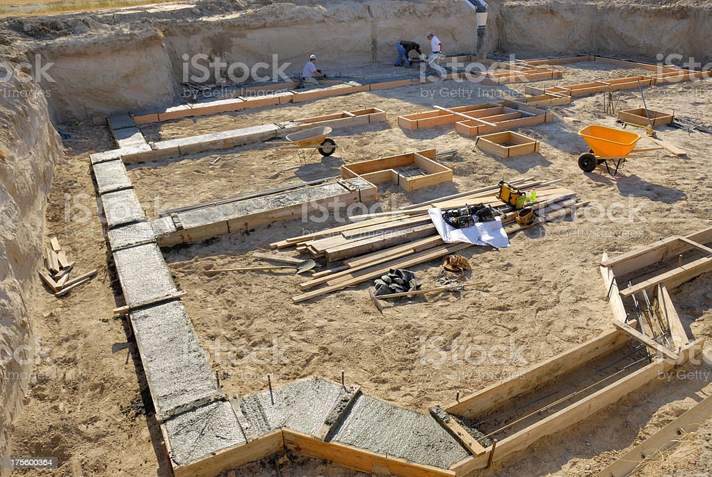 Home Construction Diary - Leveling The Cement Pour stock photo