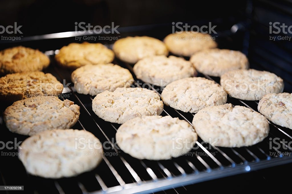 home cooked cookie style biscuits baking on oven shelf rack stock photo