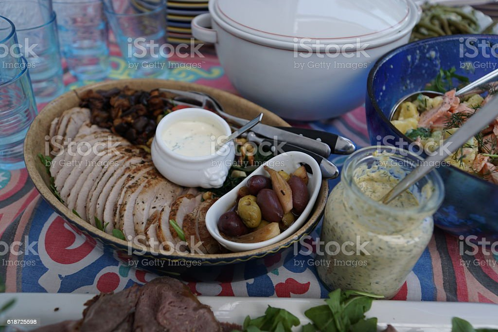 Home cooking. Antipasti. Pork tenderloin, olives and garlic. stock photo