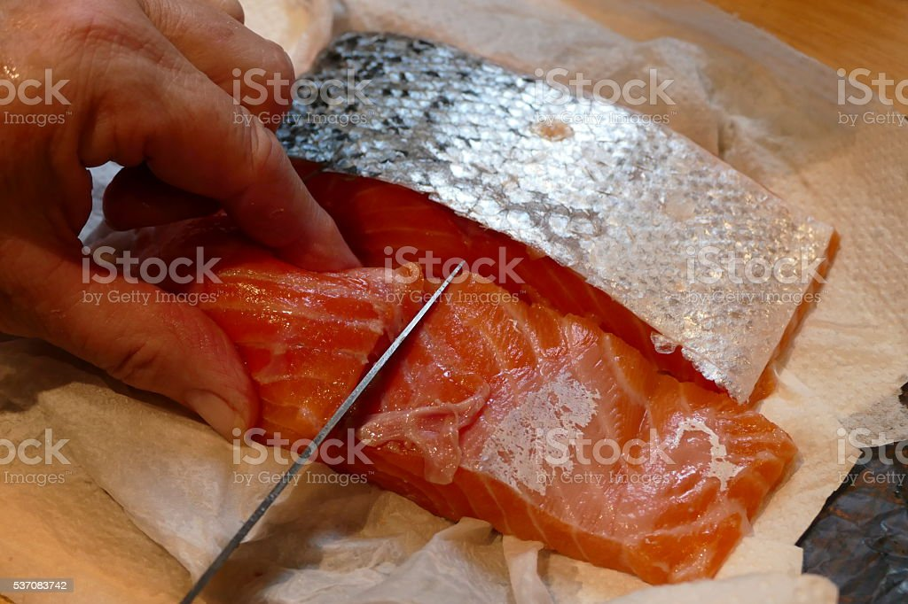 Home cooking. Salmon preparing for cooking with grandmother steamer... stock photo