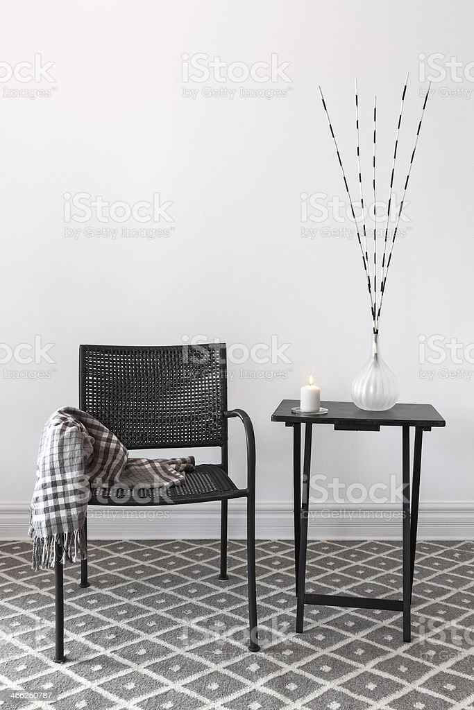 Home decor. Armchair and table with decorations stock photo