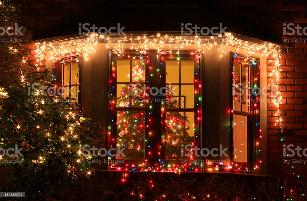 Home decorated with Christmas lights and decorations royalty-free stock photo
