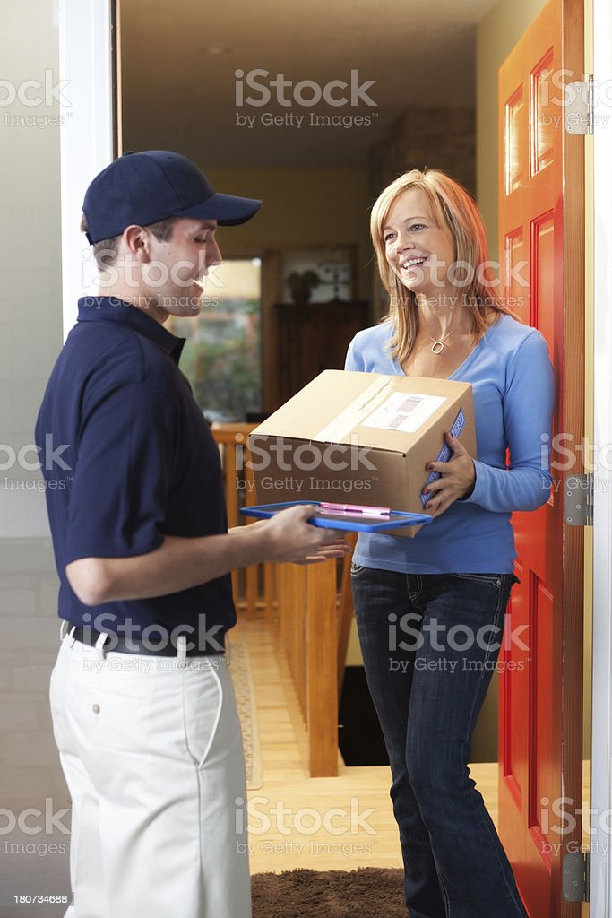 Home Delivery Service Delivering Package to Customer Vt-2 royalty-free stock photo