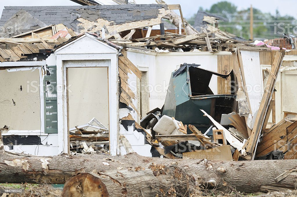 Home destroyed by tornado with dumpster royalty-free stock photo