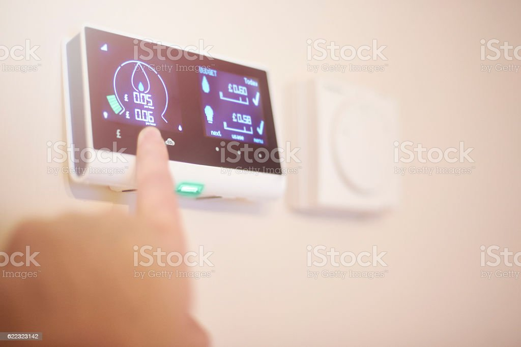 Home energy smart meter and thermostat stock photo