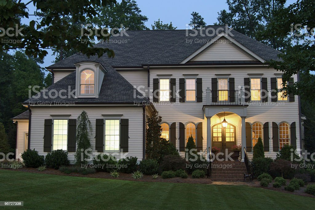Home exterior at night stock photo