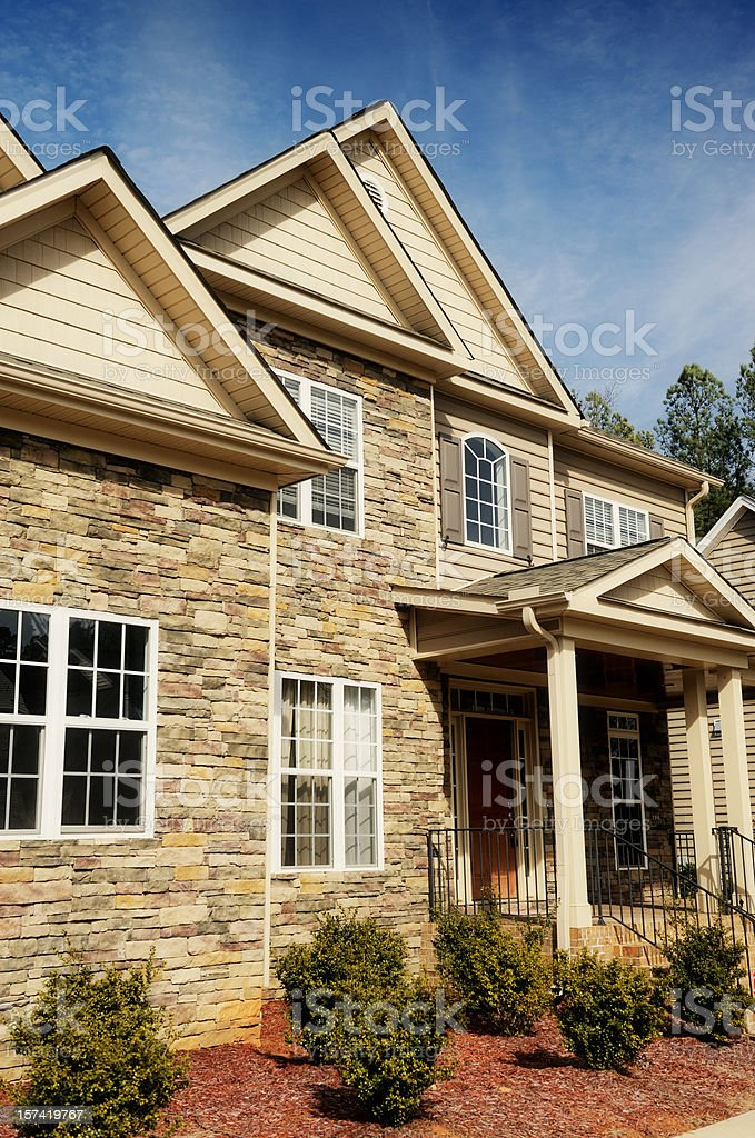 Home exterior of brick and stone royalty-free stock photo