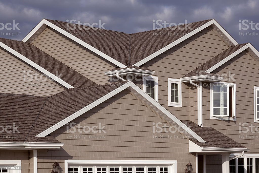 Home Exterior With Architectural Asphalt Shingle, Gabled Roof, Vinyl Siding stock photo