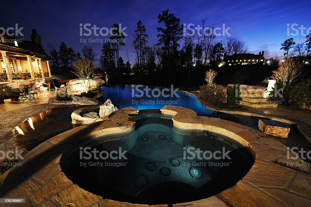 Home Exterior With Swimming Pool At Night royalty-free stock photo