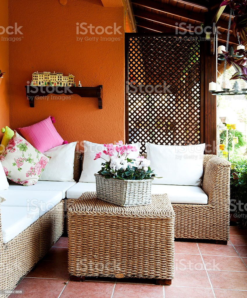 Home exterior with wicker furniture stock photo