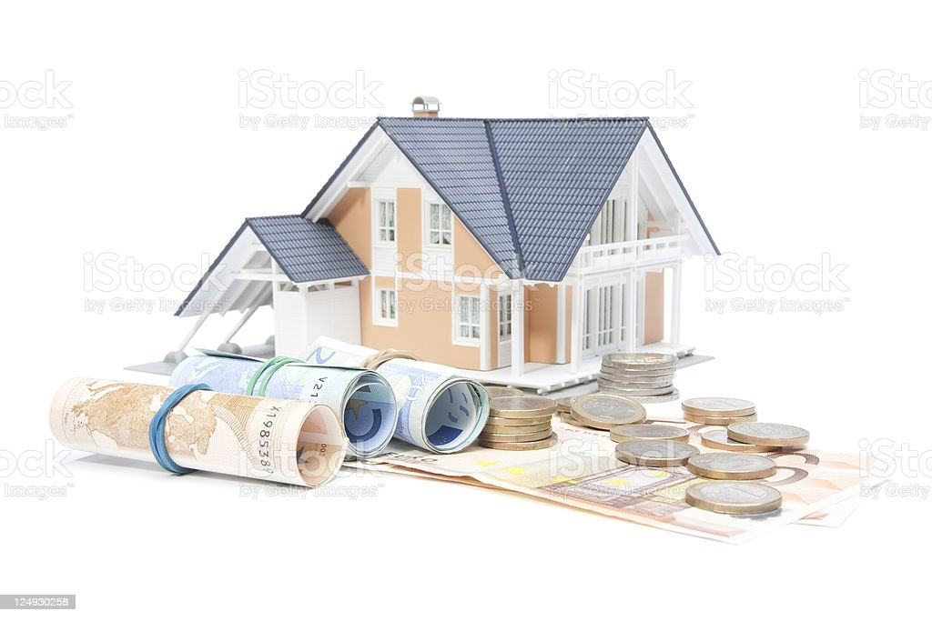 Home finances - house and money royalty-free stock photo