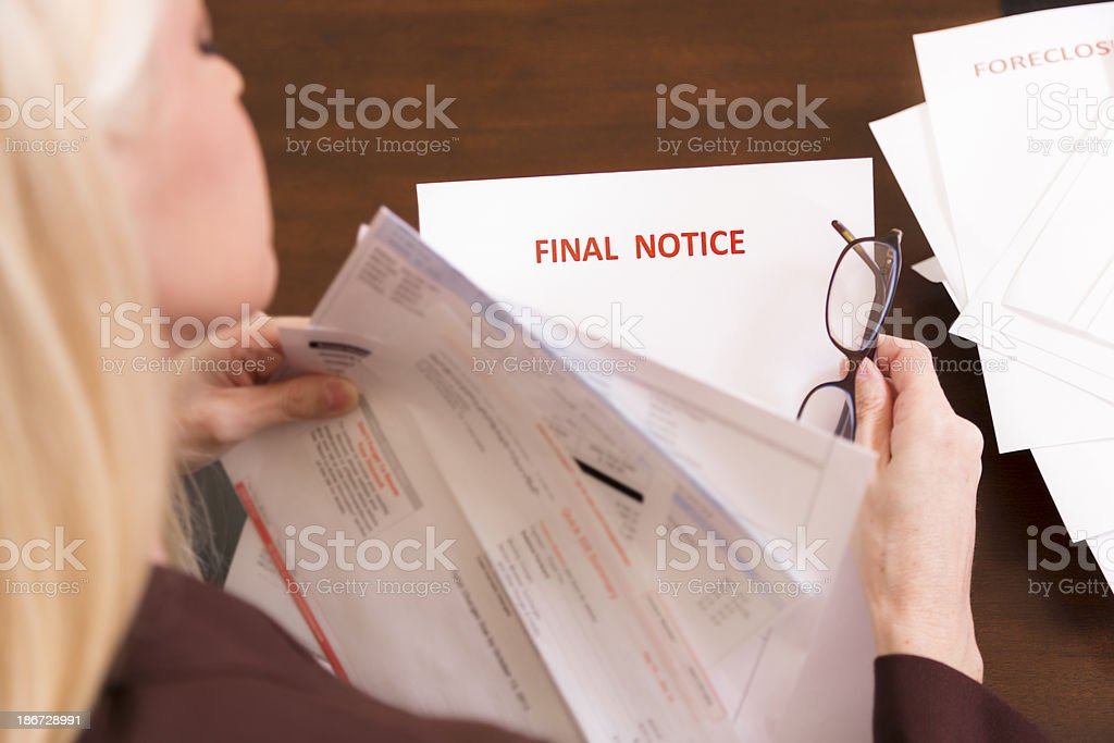 Home Finances: Woman struggles to pay her bills. royalty-free stock photo