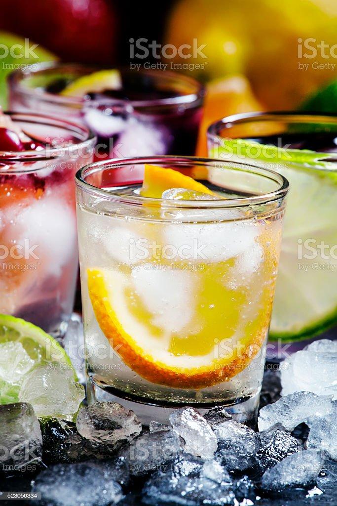 Home fizzy lemonade, fruit, ice, on a dark background stock photo