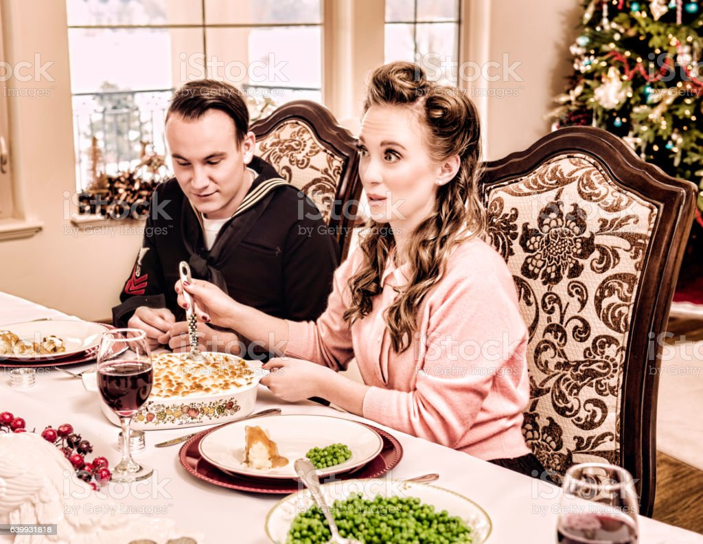 Home For Christmas Sailor and His Wife At Holiday Dinner stock photo