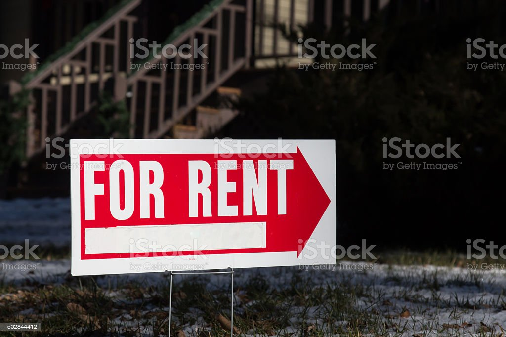 Home for rent sign with red arrow stock photo