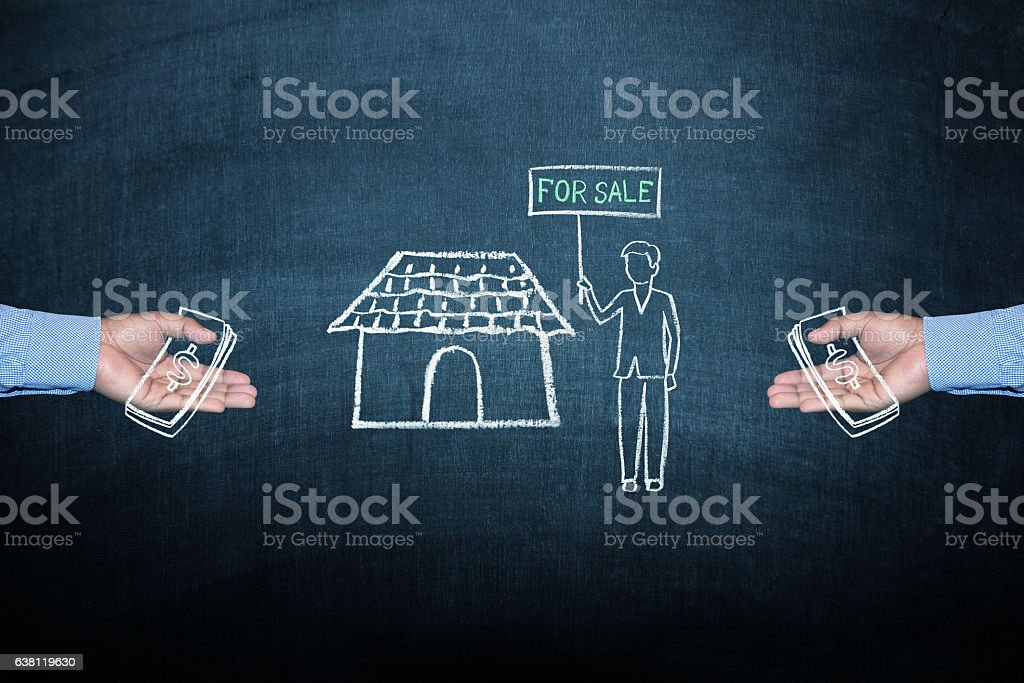 Home for sale concept on blackboard stock photo