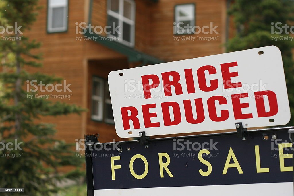 Home For Sale Price Reduced Sign stock photo