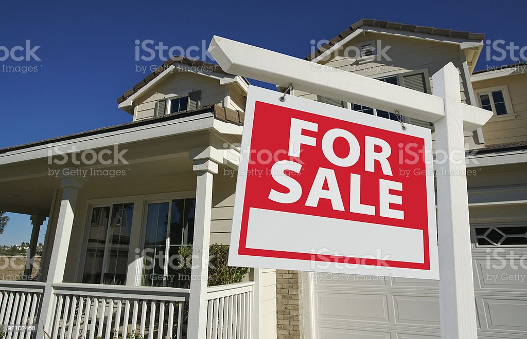 Home For Sale Real Estate Sign and New House stock photo