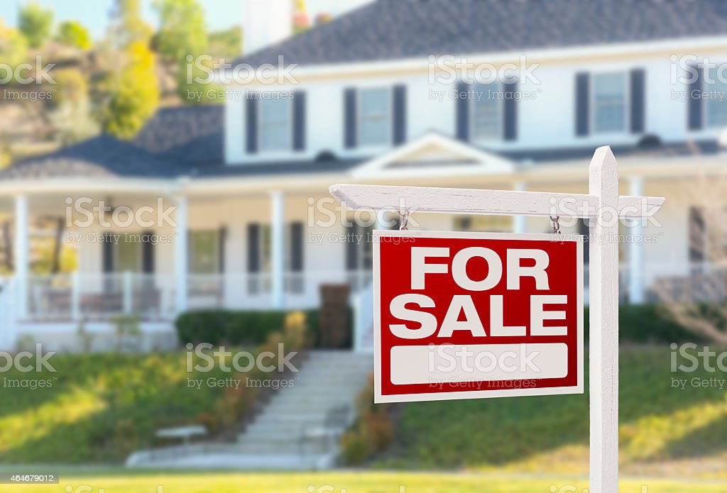 Home For Sale Sign in Front of New House stock photo