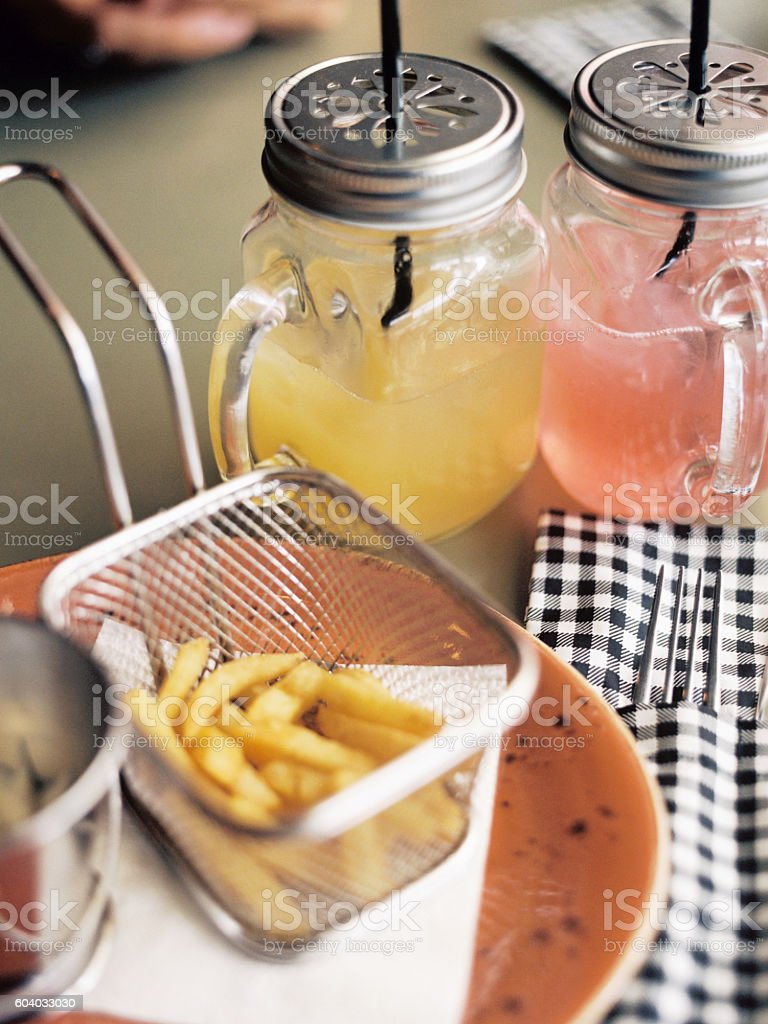 Home fries and soft drinks on table in cafe royalty-free stock photo
