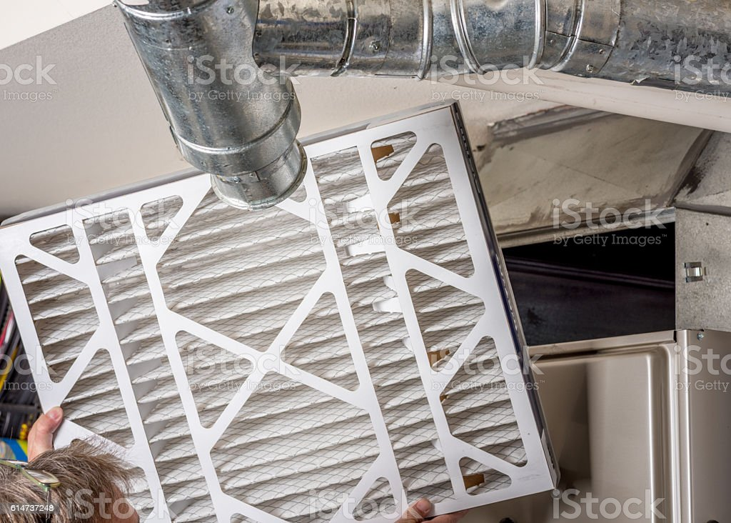 Home Furnace filter inspection for dirt stock photo
