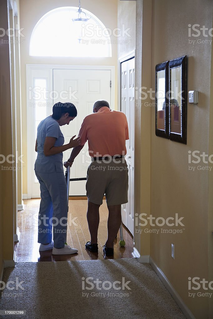 Home health aide with senior man royalty-free stock photo