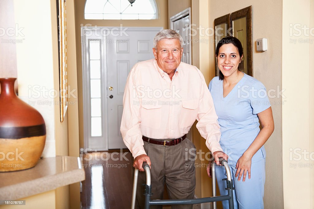 Home health aide with senior man stock photo