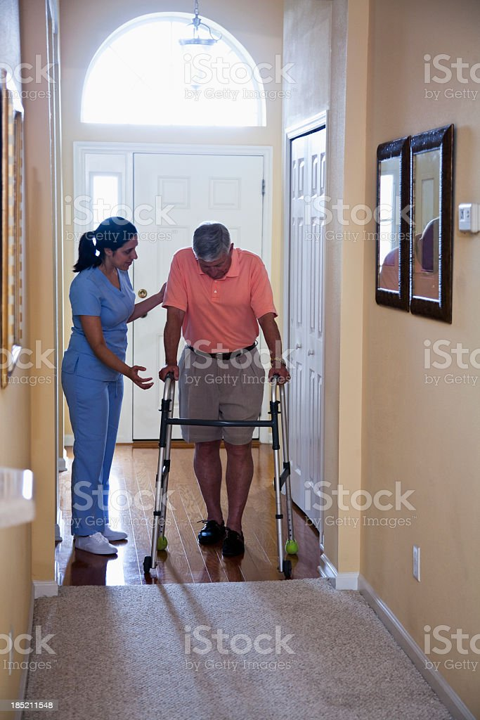 Home health aide with senior man stock photo
