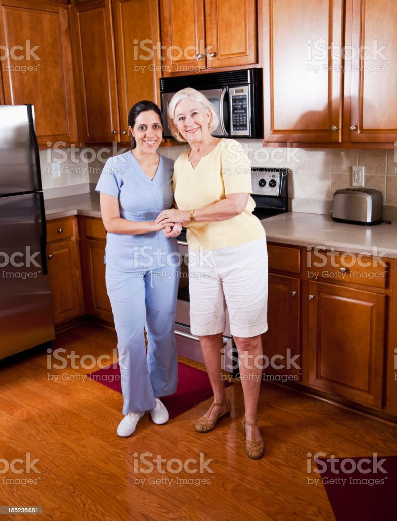 Home health aide with senior woman stock photo