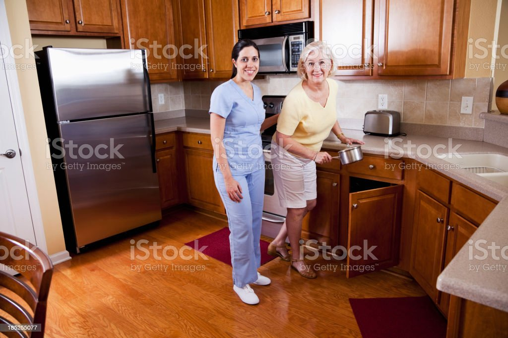 Home health aide with senior woman royalty-free stock photo