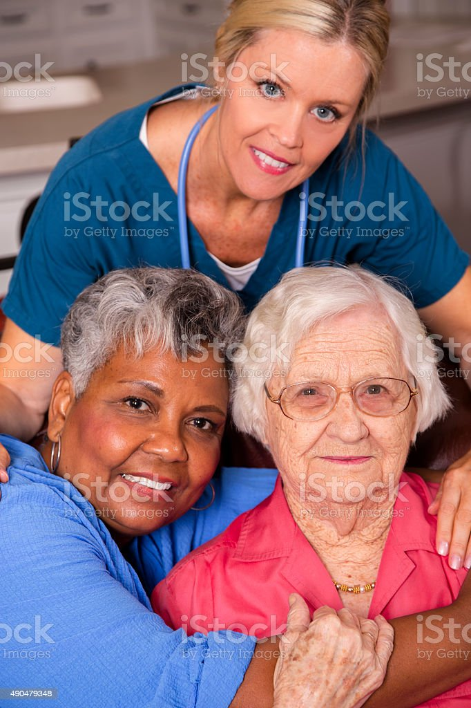 Home healthcare nurse visits her senior adult patients. House call. stock photo